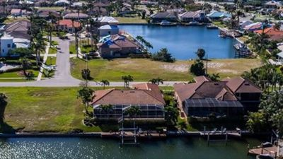 Photo for Gorgeous Waterfront Home With Heated Pool, Hot Tub, Walking To Beach & Shopping