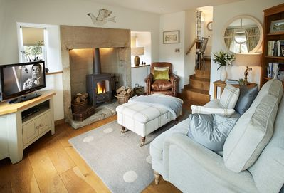 Ground floor: The sitting room with comfortable leather sofas and wood burning stove