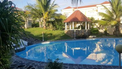 Photo for Homerez last minute deal - Spacious house with shared pool