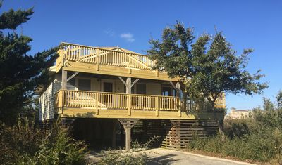 Photo for Three minute walk to the beach, ocean view, screened deck, hot tub