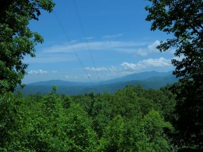 Photo for GREAT VALUE in this 3BR/3BA log with incredible views of the Smoky Mountains and the city of G'Burg.