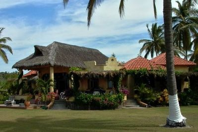 view of villa from the beachside palapa