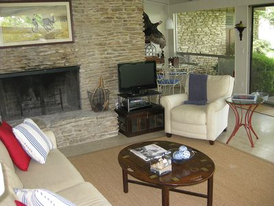 Living area with fireplace and flat screen TV and DVD player.