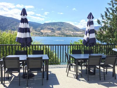 outdoor dining seats 12 off the kitchen with shade umbrellas and water misters