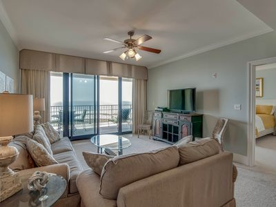Photo for NEW LISTING! Penthouse level, waterfront condo w/ shared pool, hot tub, gym