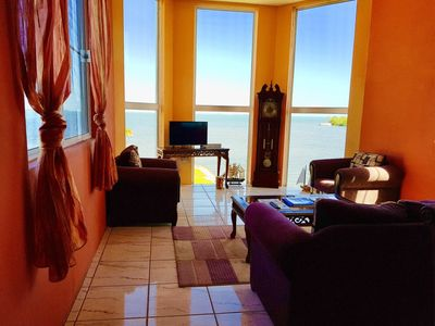See Belize SEA VIEW 2-BR PENTHOUSE with SWIMMING POOL, OVERWATER DECK, and ROOF TERRACE