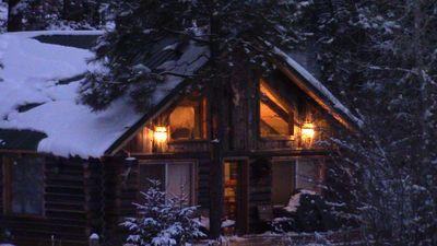 Photo for Riverfront Log Cabin, minutes away from your outdoor adventure