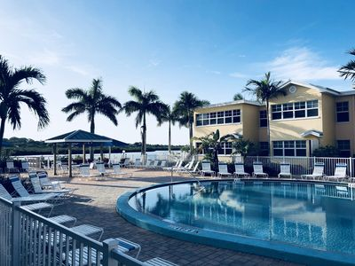 Photo for Clean tropical condo with heated pool steps to the beach and family friendly