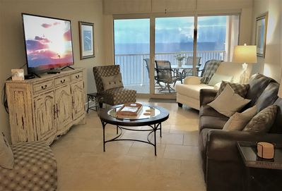 Our living room has floor to ceiling windows that overlook the Gulf of Mexico.