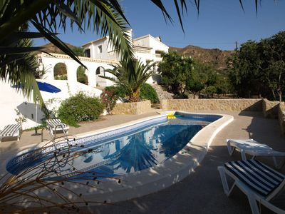 Photo for A slice of paradise with pool,orchards with stunning view of the sea /mountains