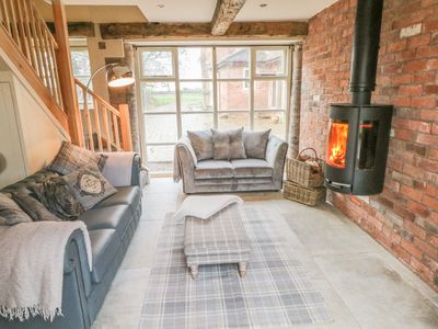 Photo for ORCHARD BARN, pet friendly, with hot tub in Fulford, Ref 998745
