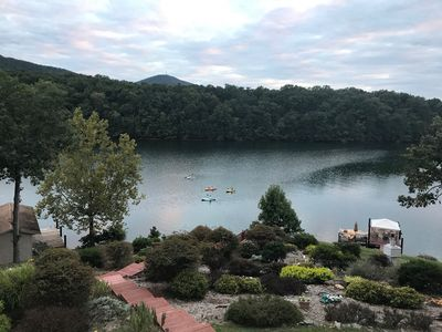 Our breathtaking view from the deck,  with lush lakeside gardens. NO WAKE COVE