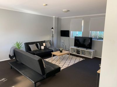 Photo for Cozy 3BR Townhouse in Liverpool CBD with dedicated underground parking spot