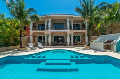 Warm inviting private pool, patio with lounge chairs, grill