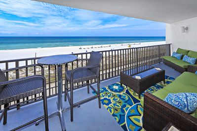 Incredible ocean front dining on high top bistro chairs and Sunbrella couches.