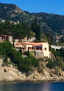 Photo for Spectacular villa built into the side of a cliff on the Mediterranean