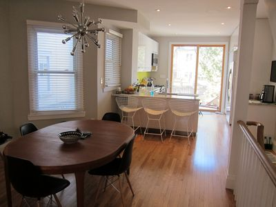 Dining room/kitchen with bar stools