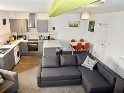 Open plan living, dining and kitchen areas.