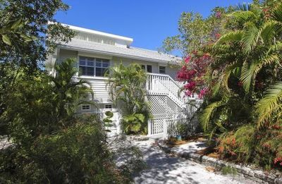 Photo for Coastal Serenity: Secluded WestEnd Oasis Pet-friendly Pool Home on the Canal!