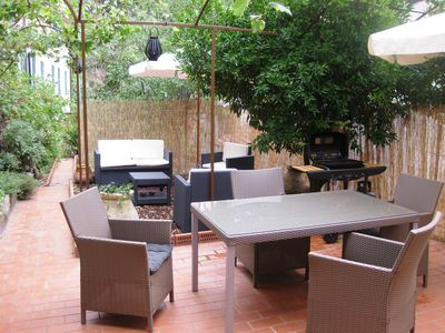 Lower garden - seating and dining area with BBQ