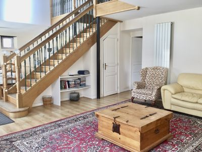 The living room showing the stairs leading to the galleried upper floor