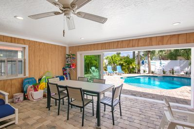 Lanai Dining  in Enclosed Porch Overlooking Pool