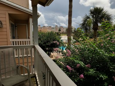 Photo for Palm Cove Condo Overlooking Pool & Tropical Landscaping!