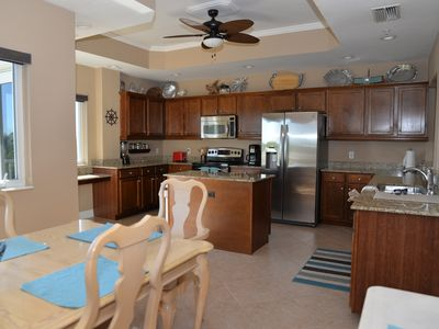 Photo for Immaculate 3 BR Condo / Views of Gulf of Mexico and Lemon Bay / Boat dock