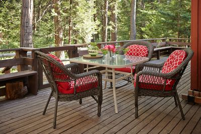 Outside deck with patio furniture and views of strawberry creek.