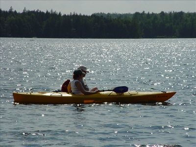 Kayaking Together in Front of Cabin