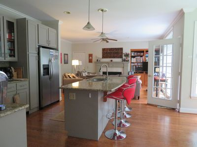 open plan kitchen, breakfast nook to right