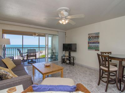 """View from hallway into living room and dining area. 40"""" HD Smart TV"""