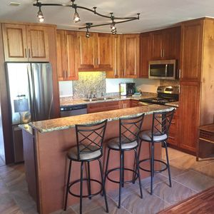 Newlly renovated kitchen with stainless steel appliances and breakfast bar