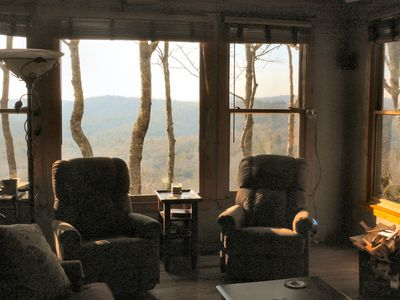 2 swivel/rocker/recliner chairs allow for watching TV, or the big view outside.