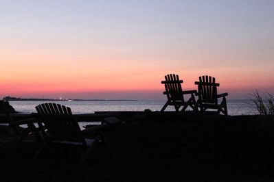 Step outside the house and enjoy the sunset on these private Adirondak chairs