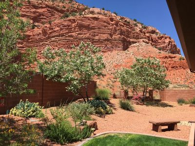 Backyard, overlooking the red cliffs behind the house.
