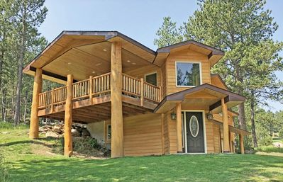 Stunning Log Home Surrounded By Trees and Close to Everything