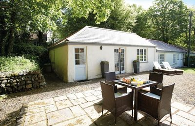 Photo for Four and a half miles south of Helston, this delightful cottage is situated on a tranquil estate.