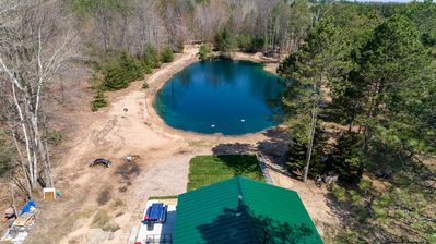 Pond view - The pond is stocked with fish for fishing, but clean and ready for swimmers!