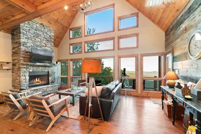 Living room with TV and wood burning fireplace