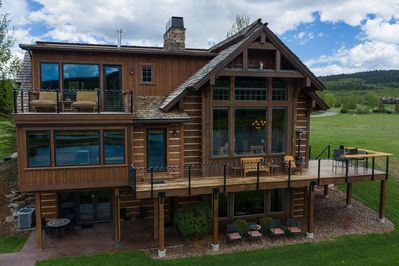 Home exterior with deck and patio