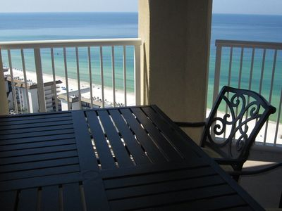 Huge outdoor patio table on balcony with great view!