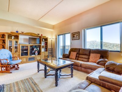 Photo for Beautiful mountain condo with shared hot tub, pool, and a fireplace!