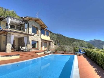 Photo for Detached villa with stunning lake views and private heated pool