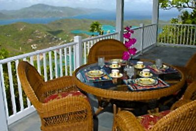Enjoy the beautiful view while dining outdoors at this wonderful St John villa