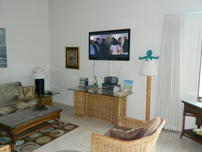 living room on upper level showing 50 inch flat screen TV