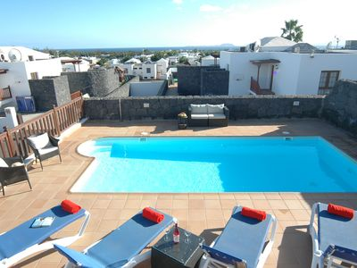 Photo for Great 4 bed villa in Playa Blanca with sea views, air con and pool table.