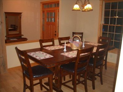 The dining room pub style table with chairs for 12