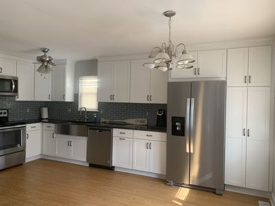 Photo for 1st fl Remodeled duplex close to beach and bay. 3 wks in Aug, 1 week in June