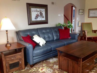 Comfortable living room with Amish-made tables & leather  couch